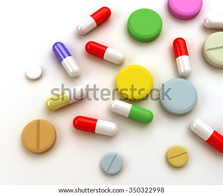 Colorful pills and tablets mixed on background.