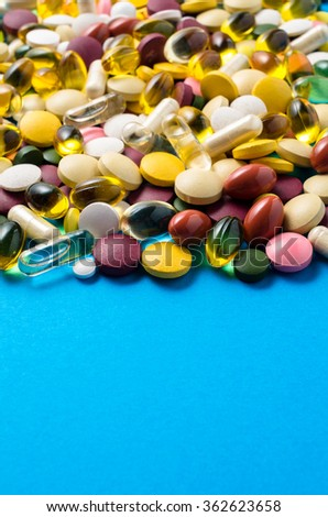Colorful pills on blue background