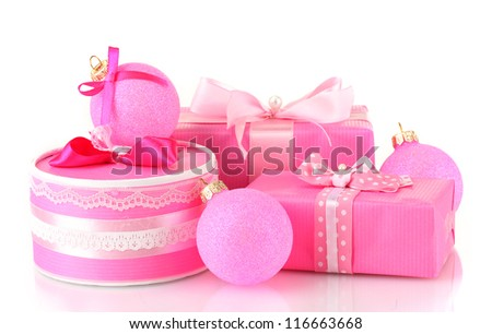 Colorful pink gifts with pink Christmas balls isolated on white - stock photo