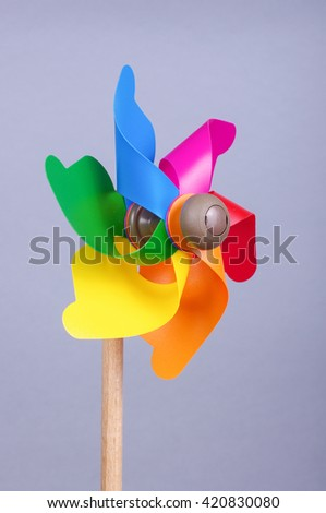 Colorful pinwheel isolated on the gray background - stock photo