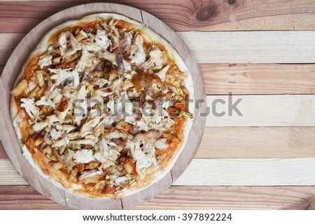 Colorful pizza with mozzarella cheese, chicken, sweet pepper and parsley close up top view. Italian cuisine home cooking. toned image - stock photo