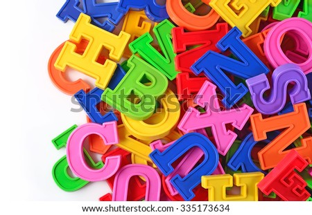 Colorful plastic alphabet letters on a white background
