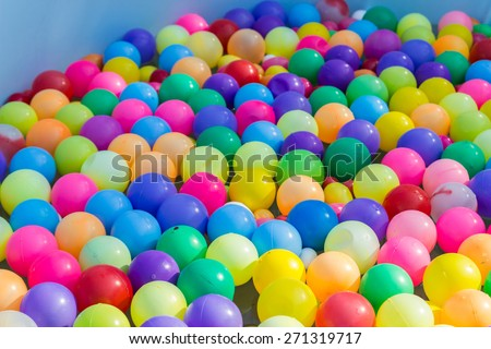 colorful plastic ball floating on water in the pool for games