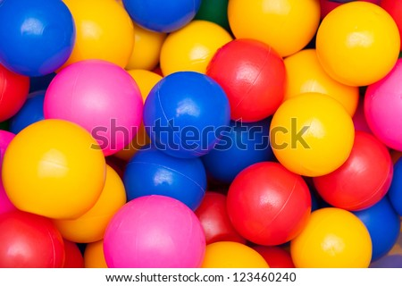 Colorful plastic balls. Bright abstract fun colors background - stock photo