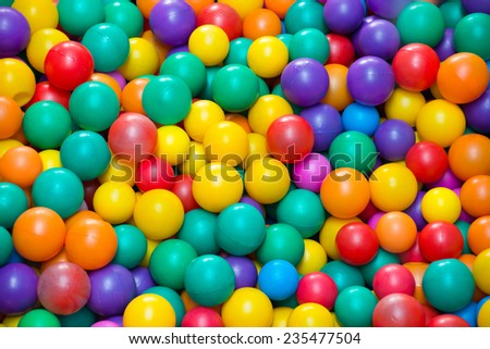Colorful plastic balls in a pool - stock photo