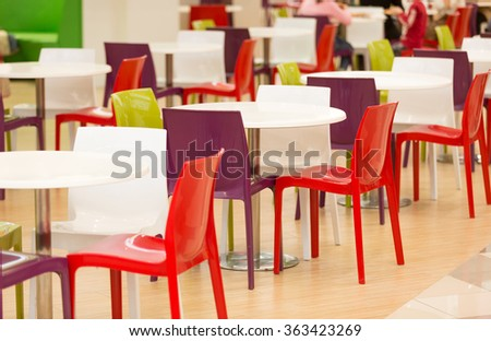 Colorful Plastic Chairs And Tables In Big Canteen
