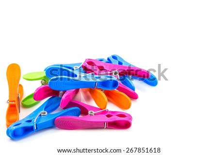 colorful plastic clothes pegs on white background - stock photo