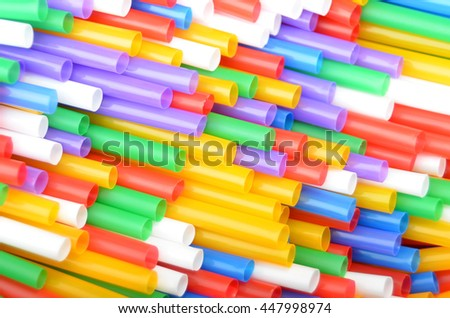 Colorful plastic drinking straws, close up as background - stock photo