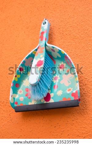 Colorful plastic dustpan - stock photo