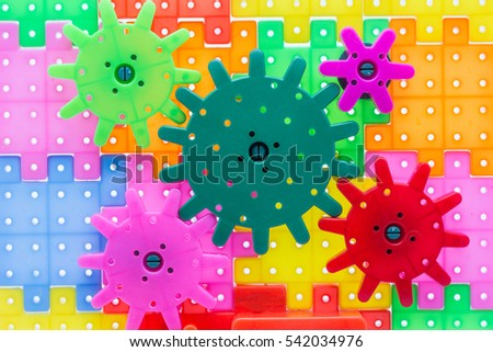 Colorful Plastic Gears toy that looks like an engine parts for kid learning