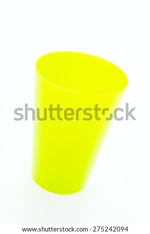Colorful plastic glass isolated on white background