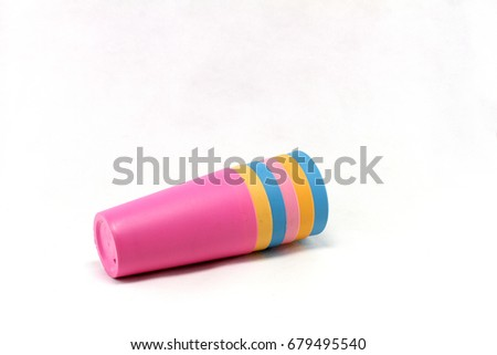 Colorful plastic glass on white background