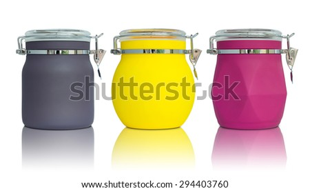 colorful plastic jar on reflect floor and white background - stock photo