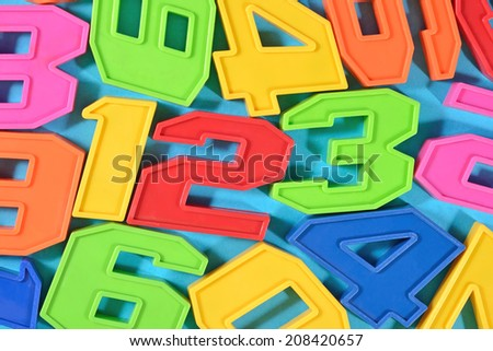 Colorful plastic numbers 123 close up