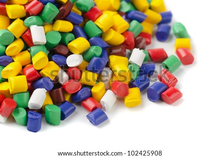 Colorful plastic polymer granules on white