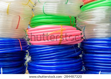 Colorful plastic rolled up hose or cable  - stock photo