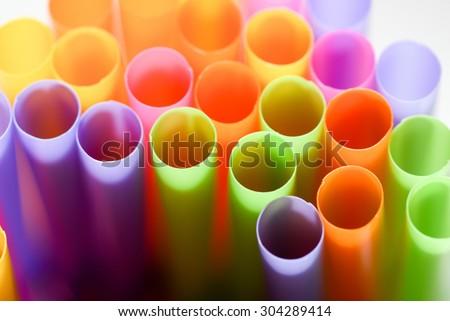 Colorful plastic straws holes.   - stock photo