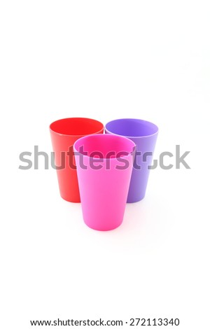 colorful plastic three cup on white background - stock photo