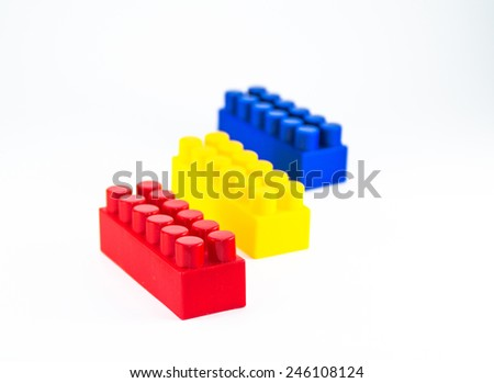 Colorful plastic toy blocks isolated on white background. Elements from the childrens designer. - stock photo
