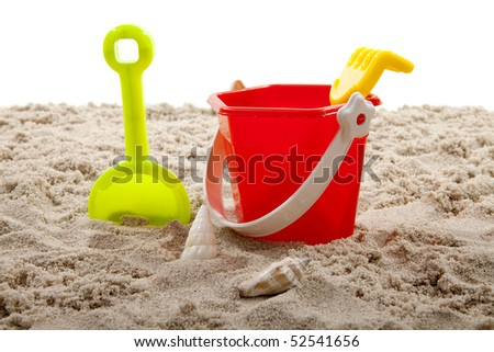 colorful plastic toys for the beach on sand over white background