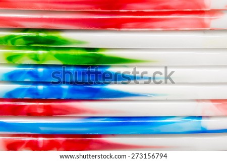 Colorful plastic tubs stacked as a background image - stock photo