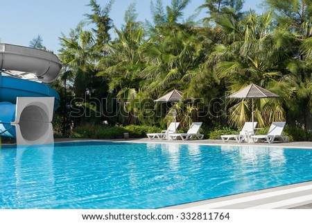 colorful plastic water-slide in swimming pool. Water park. - stock photo
