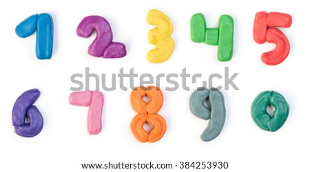 Colorful plasticine digits isolated on a white background - stock photo