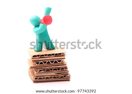 colorful plasticine guy standing on a paper podium with red bullhorn - stock photo