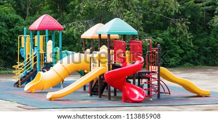 Colorful playground equipment at an outdoor park - stock photo