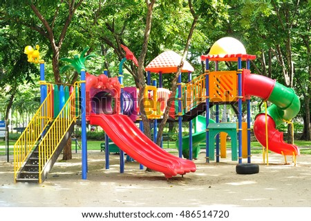 Colorful playground equipment for children in public park.