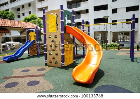 Colorful playground for childrens in public housing block. - stock photo