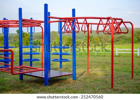 Colorful playground in front of the horse stable