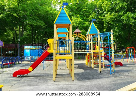 Colorful playground in public park - stock photo
