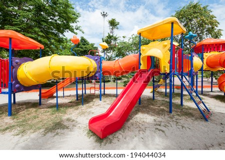 Colorful playground in the public park - stock photo