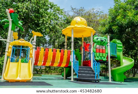 Colorful playground on yard in the park - stock photo