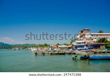 colorful port harbor pier dock in livingston guatemala - stock photo