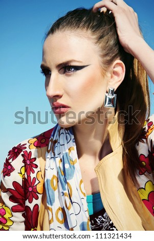colorful portrait of a girl with fashion makeup