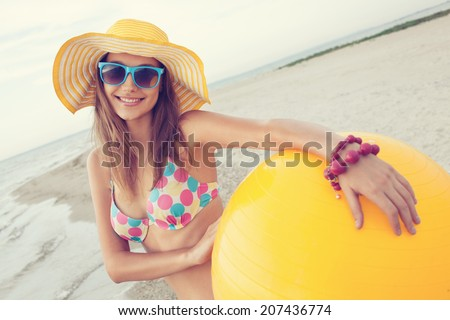 Colorful portrait of cheerful girl on the beach - stock photo