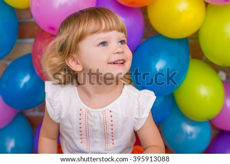 colorful portrait of cute adorable baby girl with balloons background