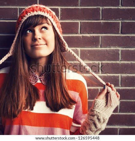 Colorful portrait of young pretty funny girl looking up and dreaming - stock photo