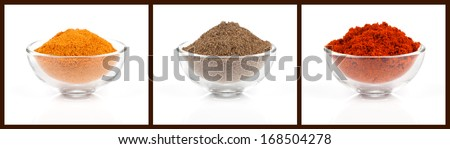 colorful powder spices in glass bowl, isolated on white background - stock photo