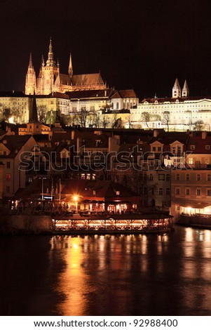 Colorful Prague gothic Castle above the River Vltava in the Night, Czech Republic