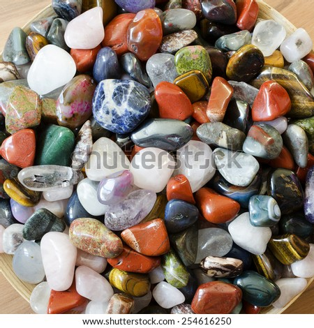 Colorful precious stones gems background. - stock photo