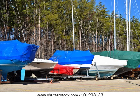 colorful protective covers on sail and power boats