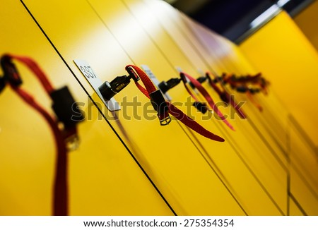 Colorful public lockers with keys in a swimming pool. Property and savings concept.  - stock photo