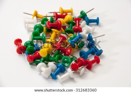 Colorful push pins on the white background. - stock photo