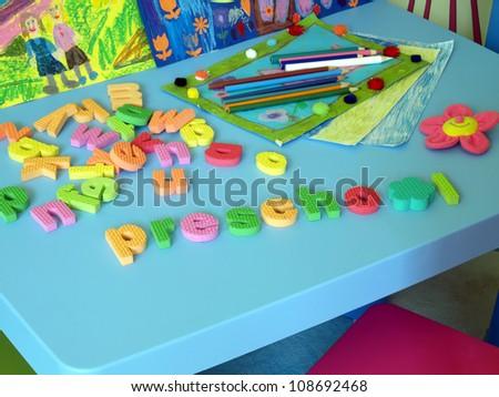 Colorful puzzle in child's preschool room - stock photo