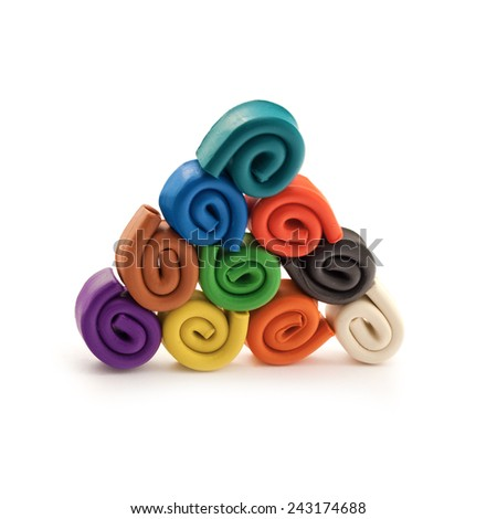 Colorful pyramid made of spirals of plasticine over white background. - stock photo