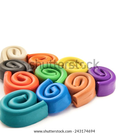 Colorful pyramid made of spirals of plasticine over white background.