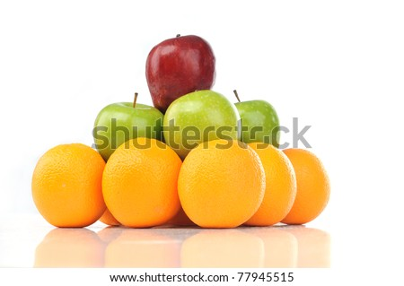 Colorful pyramid of fruits of orange, green apple and red apple isolated white background